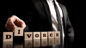 a family lawyer spelling out the word divorce in blocks