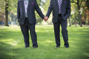 two men holding hands for a same sex marriage.