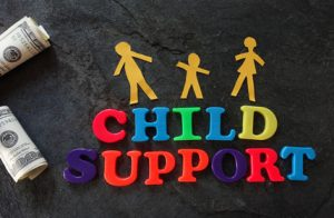 graphic for child support post with family and bills