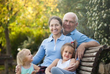 Grandparents sitting with their grandkids on a park bench. Grandparents rights