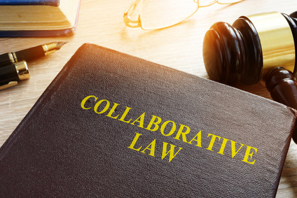 collaborative law concept with books on desk. spousal support and collaborative law