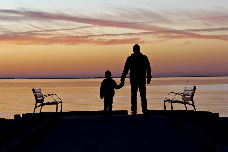 Father and son at the lakeshore. Child support in new mexico